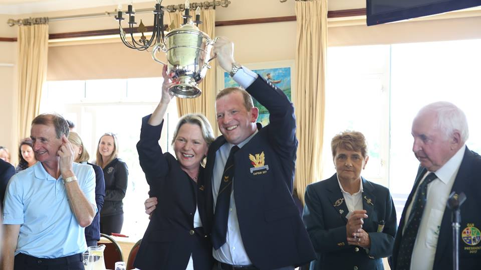 Cup held high by Captains Olive and Tony
