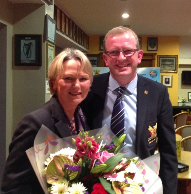 Captain Tony Flanagan presents a bouquet of flowers to Lady Captain Olive Carragher.  Both hosted the dinner