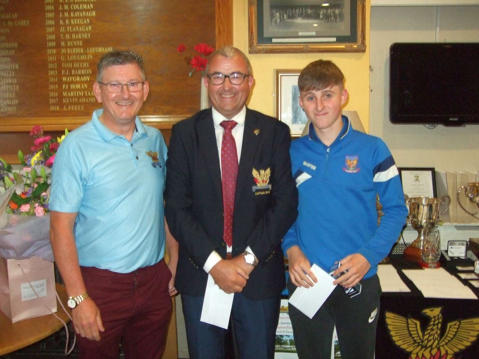 Father & Son Tom & Dan Fox receive their prize  from Captain Brian Gunning in the Paul Burke Cup