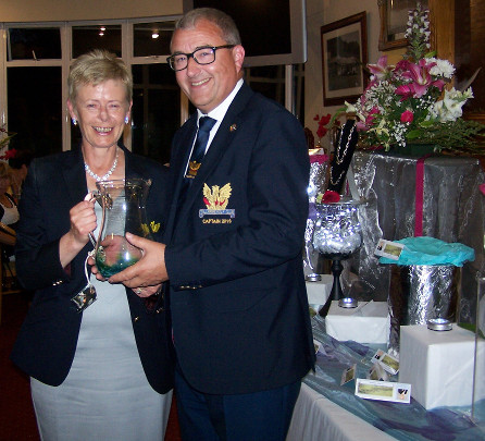 Captain Brian accepting the groos prize on behalf of his sister, Catherine