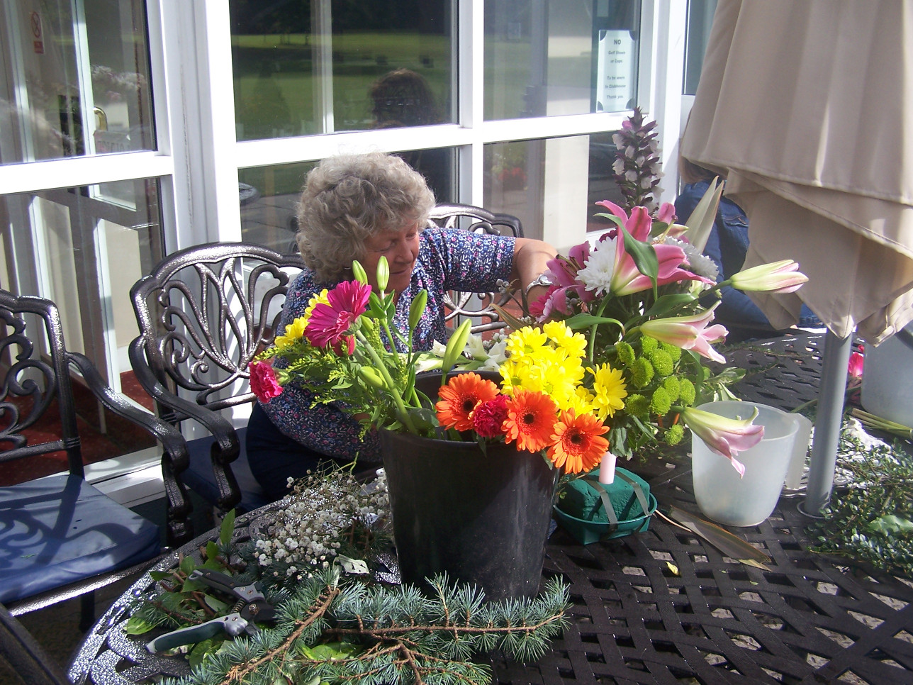 Olive Payne - The lady responsible for most of the beautiful flower arrangements busy at work